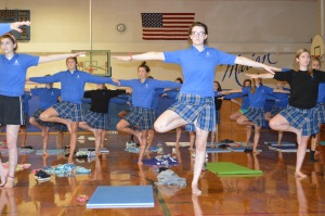 Yoga Club members try new poses. Photo by Clara Wertzberger.