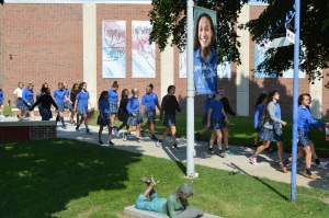 Juniors file out of the Quad doors for the fire drill. Photo by Molly Miller.