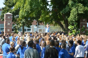 "Student receive the ""all clear"" command and return to the building after the fire drill. Photo by Molly Miller."