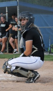 Softball Spirit Emma Raabe '18 crouches at home plate, waiting to catch the ball at the Varsity Marian v. Millard West home game on Sept. 3, 2015. The Varsity team won 4-3! photo by noellepick