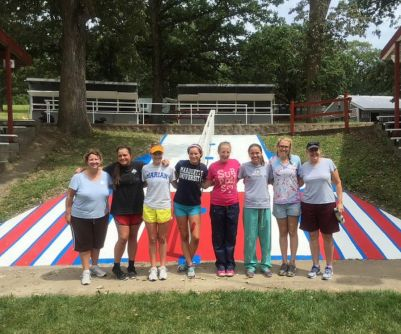 Winning in Winnebago. The students of the Winnebago Service Trip pose with theology teacher Mrs. Lori Spanbauer and principal Mrs. Susie Sullivan in front of a newly painted ramp.  Photo courtesy of Mrs. Spanbauer