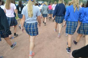Students clad in spirit shirts and sneakers finish their stroll along the track. Photo by Noelle Pick