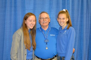 Mr. Richard Hutfless and his two Marian granddaughters at Grandparents Day on Oct. 8. Photo by Vicki Ackermann