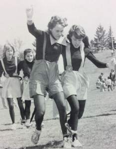 Two students race to victory in the three-legged race. photo by The Marian 1982