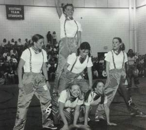 Cheer performs in the Marian gym, as rain made them unable to go to Benson Park. photo by The Crusader 1999