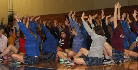 Students participate in the exercises for the Mindfulness presentation.