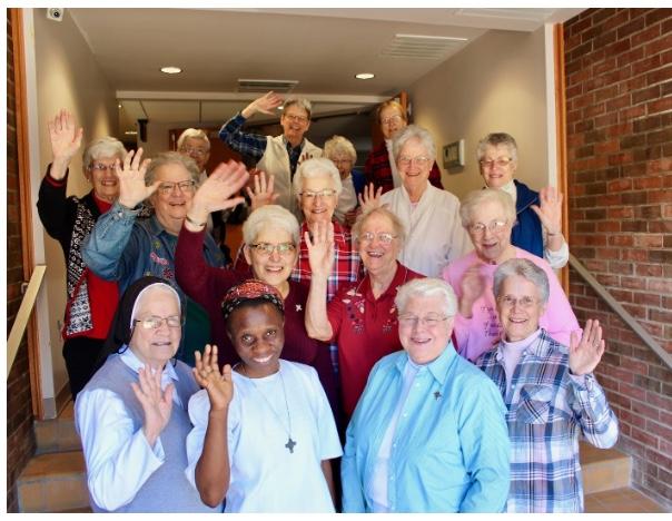 servants of Mary waving